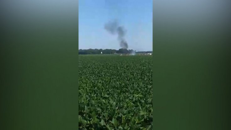 Video shows aftermath of fatal mid-air military plane explosion and crash