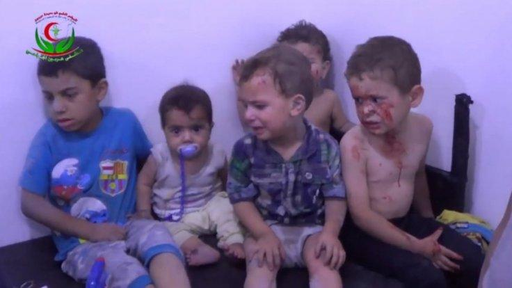 Wounded children treated after air strikes defy ceasefire in Syria