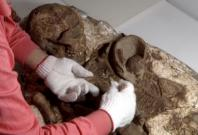 4,800-year-old remains of mother cradling her baby found in Taiwan