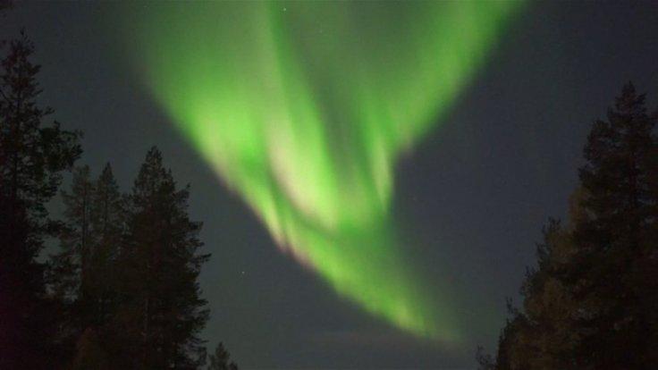 Beautiful Northern lights illuminate sky in Finland