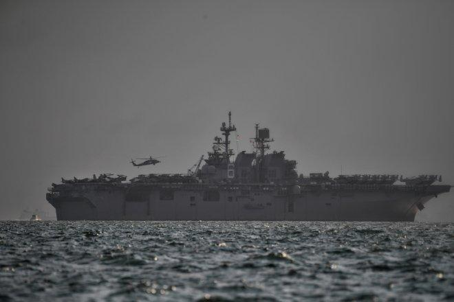 U.S Navy's USS America, which is supporting ongoing search for missing crew members of USS John McCain,...