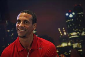 Former Manchester United player Rio Ferdinand smiles as he meets the media during a promotional event