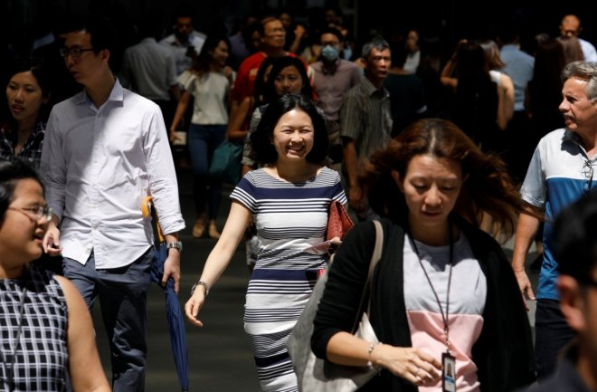 Office workers head for lunch at central business district in Singapore