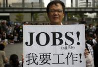 An activist demanding jobs in a demostration in Taipei
