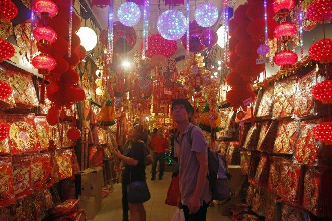 People shop for new year decorations ahead of the Lunar New Year in Chinatown in Singapore