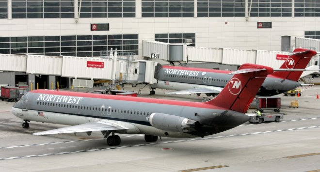 Northwest Airlines aircraft taxies into gate at Detroit Metropolitan Airport