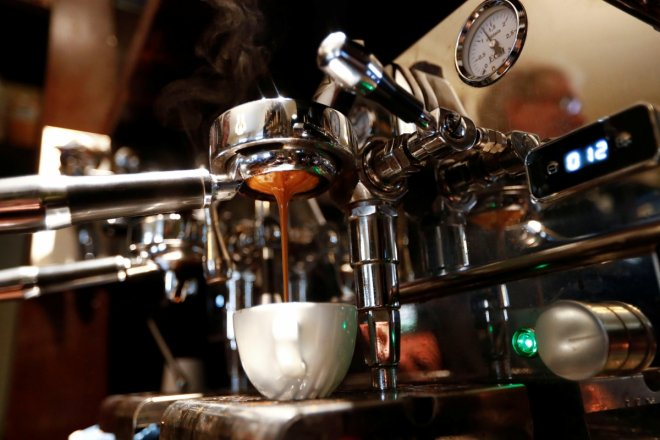 Espresso is poured in cup at Ridders Coffee roastery in Berlin