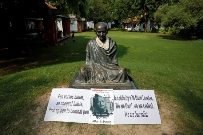 Placards are placed in front of state of Gandhi during protest against killing of Gauri Lankesh