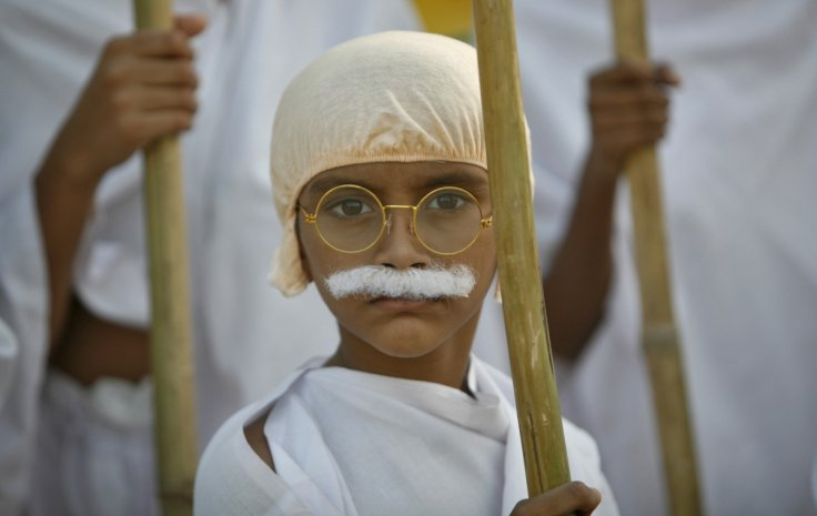 A school boy dressed as Mahatma Gandhi takes part in a march to mark the 143rd birth anniversary of Gandhi in the western Indian city of Ahmedabad October 2, 2012. Mahatma Gandhi, also known as the