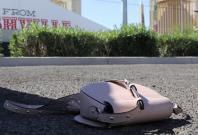 A handbag is seen on the street next to the site of the Route 91 music festival mass shooting outside the Mandalay Bay Resort and Casino in Las Vegas, Nevada, U.S. October 2, 2017. REUTERS/Lucy Nicholson
