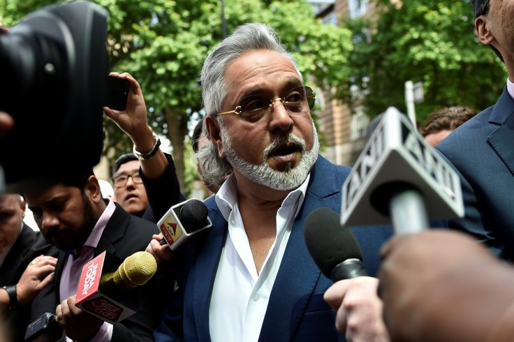 Force India co-owner, Vijay Mallya, talks outside Westminster Magistrates, in central London