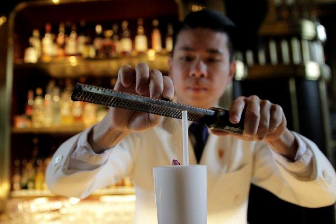 A barman prepares an Imperial Fizz Nouveau at the Atlas Bar