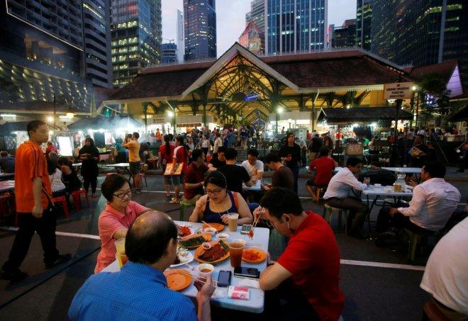 People eat at Lau Pa Sat food centre in Singapore July 29, 2016