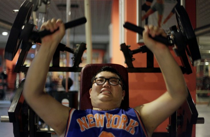 A man lifts weight as part of his training during a six-week programme in an exercise room at the Bodyworks weight loss campus in Beijing August 26, 2011. Participants at the Bodyworks weight loss campus come from across China, paying 30,000 yuan ($4,696)