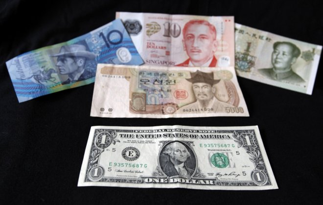 Asian currencies drop on Yellen comments