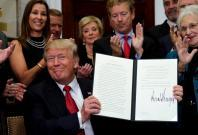 U.S. President Donald Trump smiles after signing an Executive Order to make it easier for Americans to buy bare-bone health insurance plans and circumvent Obamacare rules at the White House in Washington, U.S.