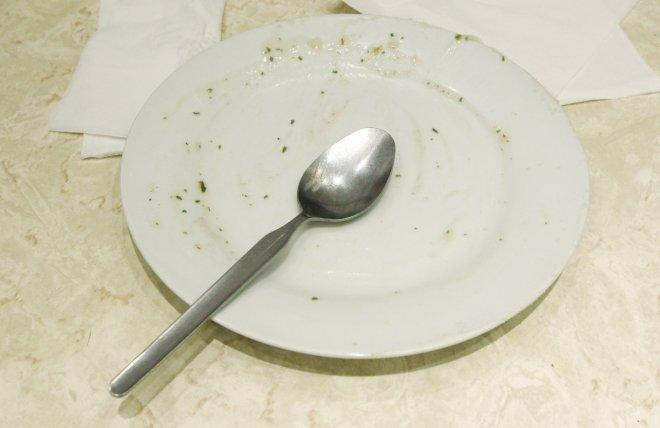An empty plate is left at a table following a Pie and Mash Club meeting at G. Kelly's pie and mash shop