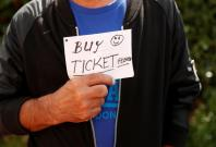 Football Soccer - Premier League - Swansea City vs Manchester United - Swansea, Britain - August 19, 2017 A man holds a sign looking for a ticket before the match Action Images via Reuters