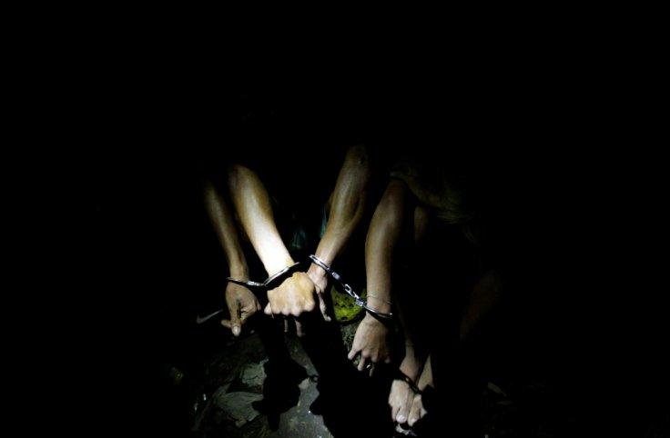 Men are handcuffed after they were detained by police during a police anti-illegal drugs operation in Quezon city, Metro Manila, Philippines November 9, 2016. Picture taken November 9, 2016. REUTERS/Czar Dancel TPX IMAGES OF THE DAY