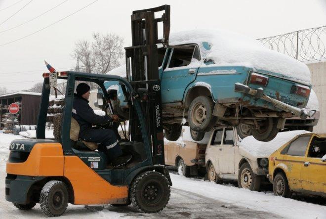 Forklift lifting a car