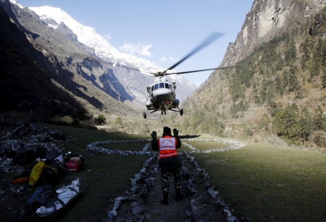 A helicopter arrives at a trekkers camp to evacuate Israeli solders after a mission to rescue climbers affected by last week's earthquake from the Himalaya mountains near Dhunche, Nepal, May 3, 2015. REUTERS/Olivia Harris