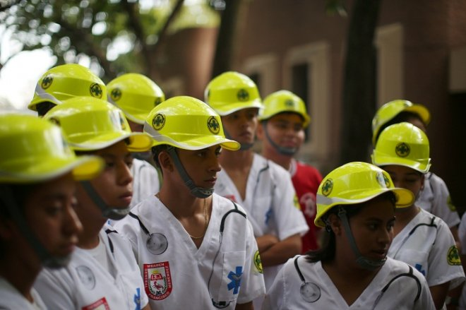 Students of the Francisco Menendez National Institute prepare to participate in a national earthquake...