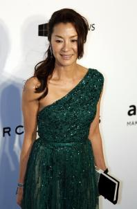 Malaysian actress Michelle Yeoh poses upon arrival at the Foundation for AIDS Research's (amfAR) inaugural fundraising gala in Hong Kong March 14, 2015.