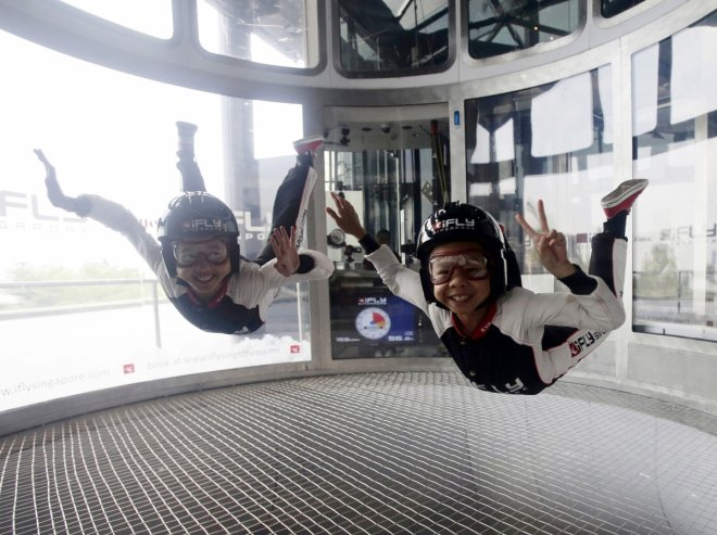 Indoor skydivers 10-year-old Kyra Poh and 11-year-old Choo Yi Xuan