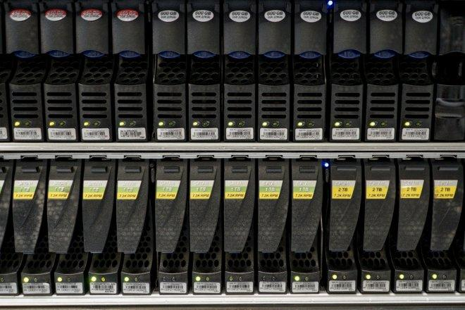 Hard disks are pictured inside a server room at a company in Bangkok
