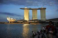waterfront as sunlight shines on the Marina Bay Sands