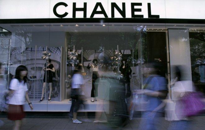 people walking past Chanel
