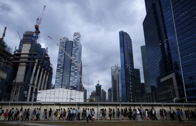 SingaporeCommuters walk to the train station during evening rush hour in the financial district of Singapore