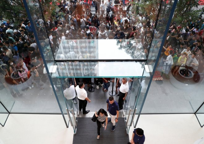 People queue to buy iPhone X during its launch at the Apple store in Singapore