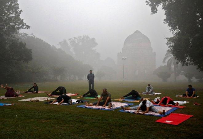 People exercise in a park on a smoggy morning in New Delhi.