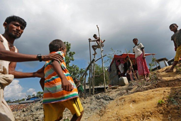 Rohingya refugees manually drill borewell at Palong Khali refugee camp near Cox's Bazar