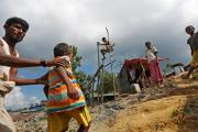 Rohingya refugees manually drill borewell at Palong Khali refugee camp near Cox's Bazar