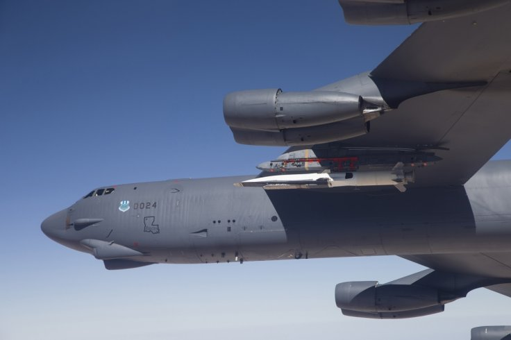 A U.S. Air Force B-52 carries the X-51 Hypersonic Vehicle out to the range for a launch test