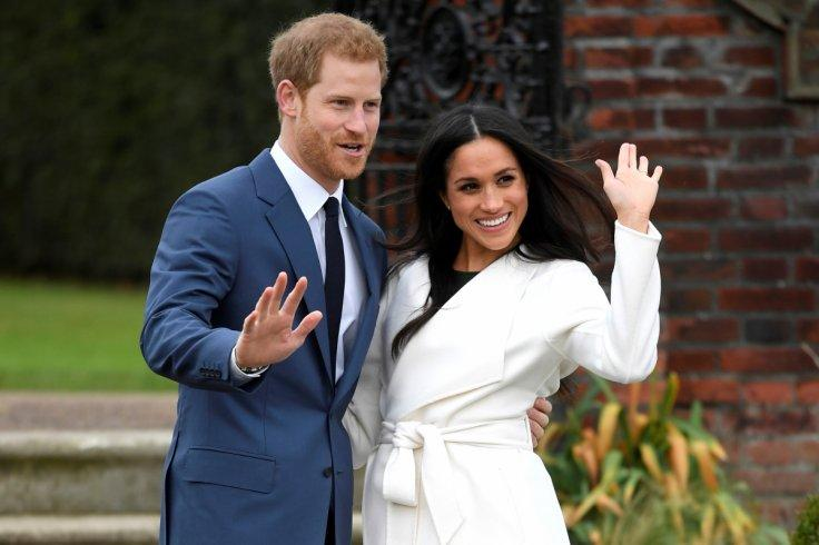 Britain's Prince Harry poses with Meghan Markle in the Sunken Garden of Kensington Palace, London, Britain,