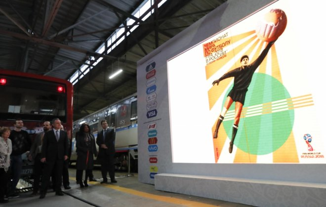Participants, including FIFA Secretary General Fatma Samoura and Russian Deputy Prime Minister Vitaly Mutko, attend a ceremony unveiling the Official Poster for the 2018 FIFA World Cup Russia