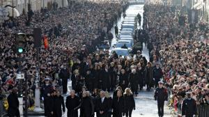 Thousands gather in Paris for French rock legends funeral