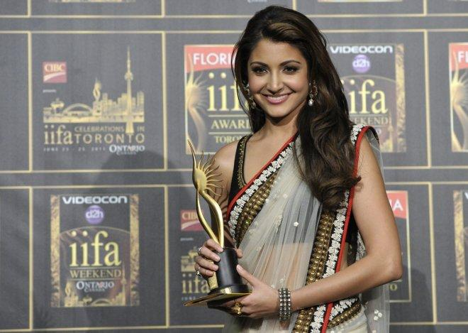 Anushka Sharma poses with her award during the International Indian Film Academy