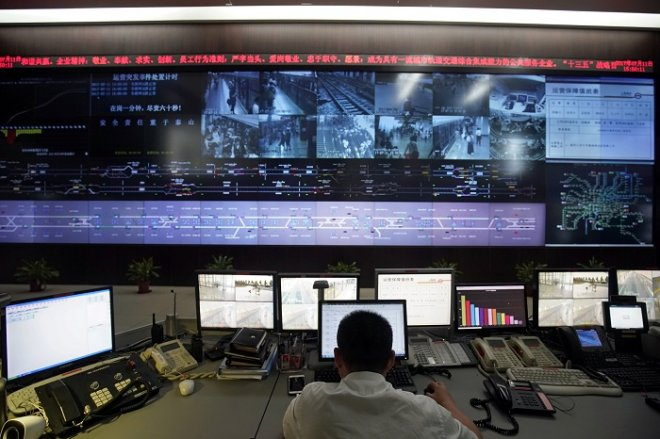 An employee works at Shanghai Shentong Metro Group's comprehensive operation coordination center in Shanghai