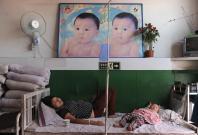 File photo of an ethnic Uighur woman on a drip at a hospital in Shaya county of Aksu