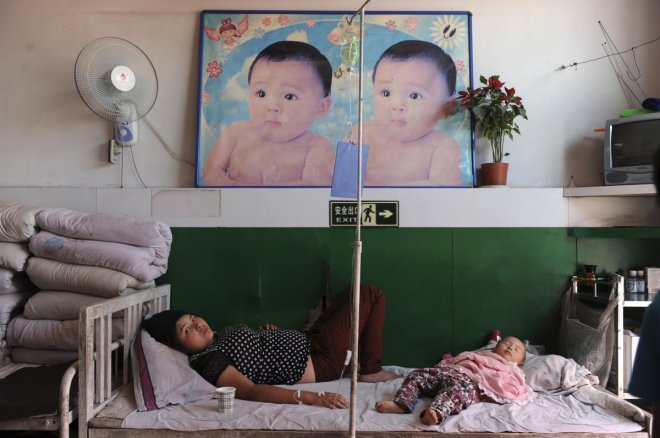 File photo of an ethnic Uighur woman on a drip at a hospital in Shaya county of Aksu