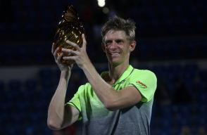 Kevin Anderson of South Africa holds the trophy after wining his match against Roberto Bautista Agut of Spain.