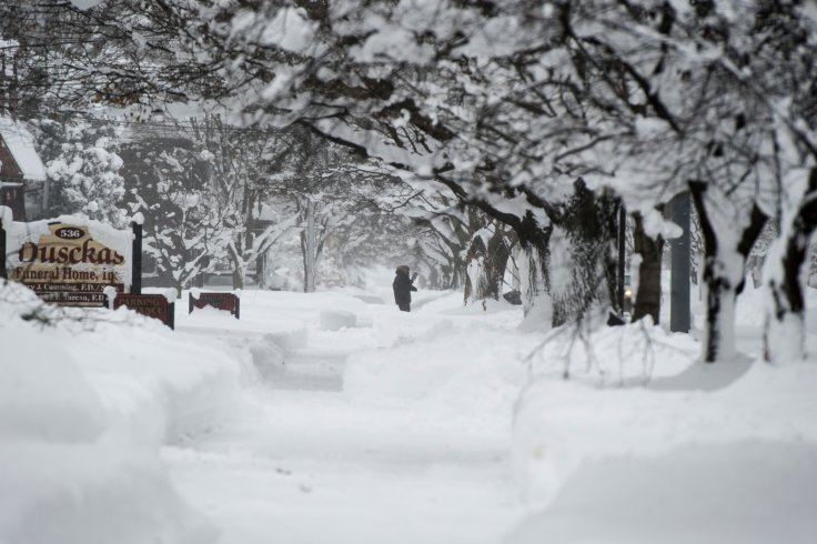 A resident seen attempting to walk through the snow on 10th street after two days of record-breaking snowfall in Erie, Pennsylvania, U.S
