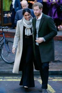 Prince Harry and Meghan Markle leave after a visit to Reprezent Radio at Pop Brixton in London