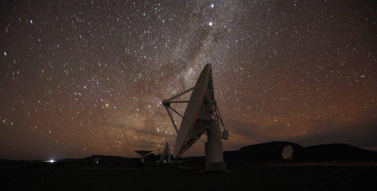 Night falls over radio telescope dishes of the KAT-7 Array at the proposed South African site for the Square Kilometre Array (SKA) telescope near Carnavon in the country's remote Northern Cape province