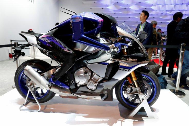 Autonomous motorcycle-riding humanoid robot