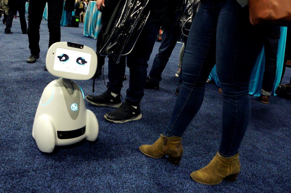 Buddy robot by Blue Frog roams the floor during the opening event at CES in Las Vegas, Nevada